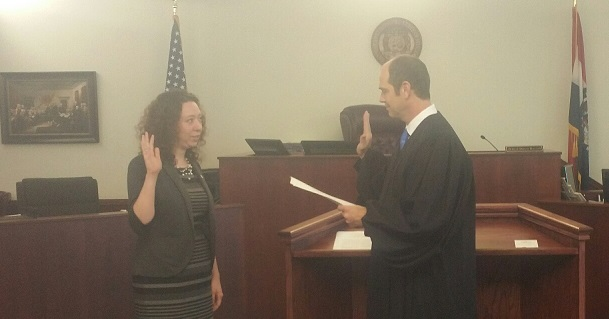 Shown in the picture is Judge Bacon swearing her in as Assistant Prosecuting Attorney.