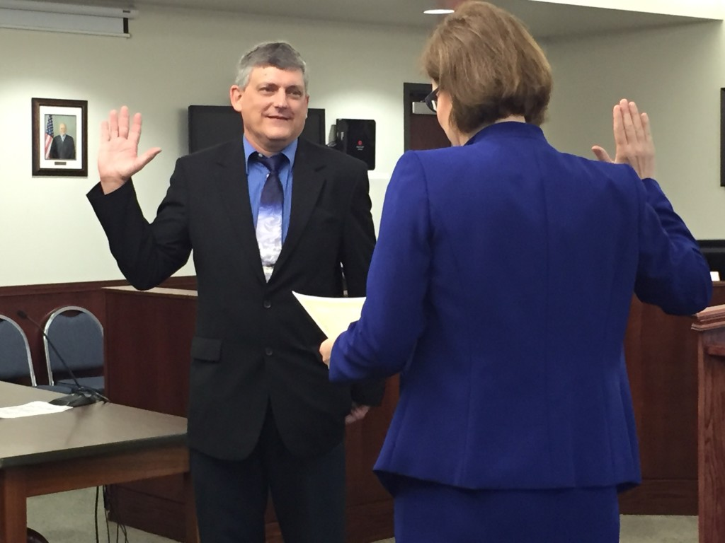 Shown is new Sr. APA John Young being sworn in by Prosecuting Attorney Amy Fite