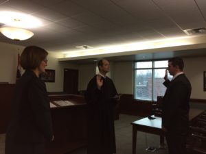 Prosecuting Attorney Amy Fite observes the swearing in of new Assistant Prosecuting Attorney Dustin Birch by Judge Doug Bacon